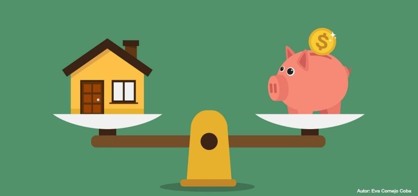 Casa y marranito alcancía en una balanza, representa el ahorro con el crédito especial para vivienda sostenible